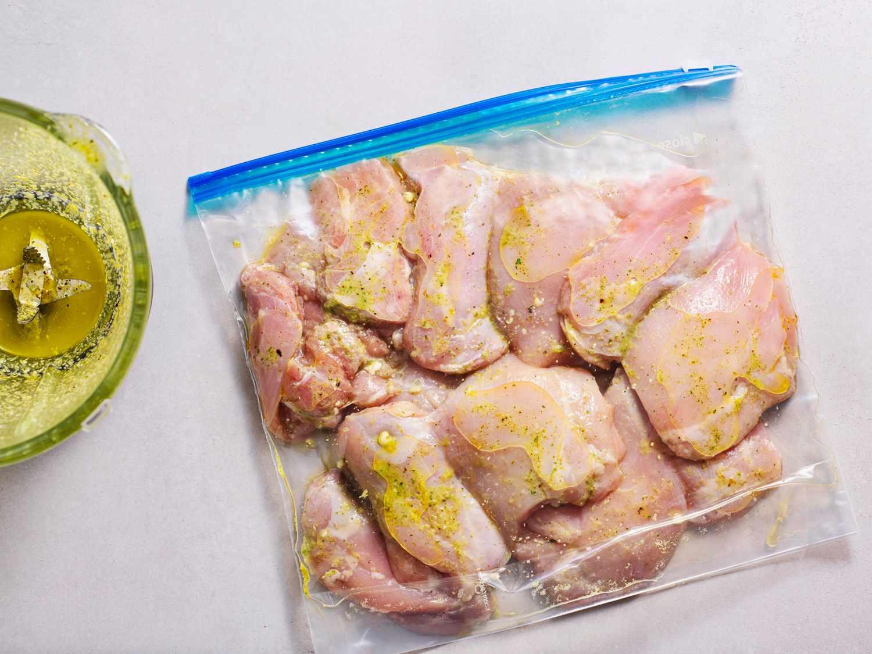 chicken covered in marinade in a zipper-lock bag