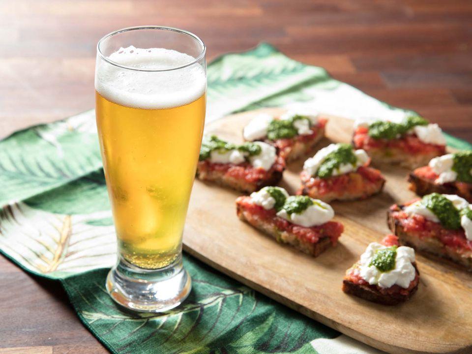 20180913-beer-pairings-crisp-clean-beer-pantry-burrata-tomato-pesto-toast-vicky-wasik-beer-in-glass