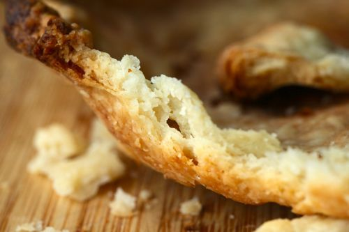 Close-up cutaway photo showing crumbly pie dough where water was incorporated in a food processor.