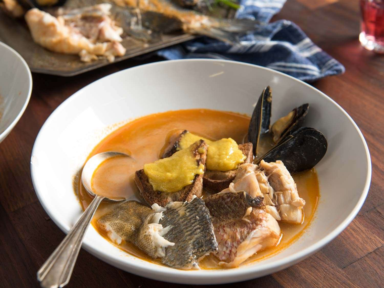 Close up of a serving of bouillabaisse at the table