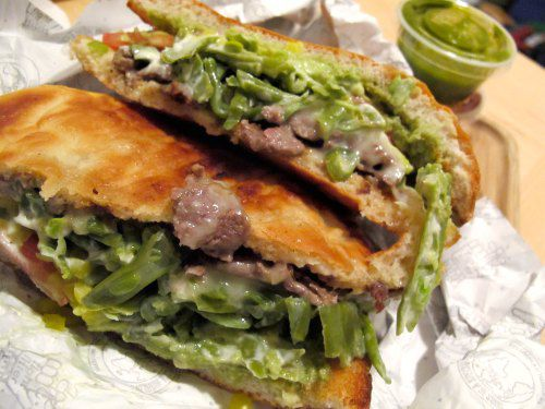 A Chacarero sandwich with beef and green beans