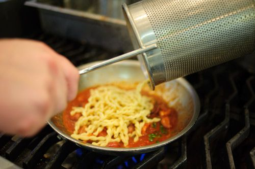2009-7-11-Marea-adding-pasta-to-pan.jpg