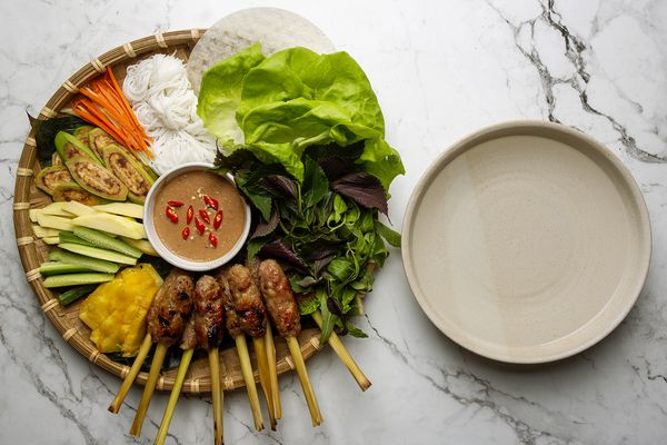 nem lui platter with a bowl of warm water alongside