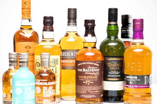 An assortment of bottles of single malt scotches.