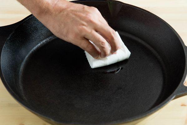 Seasoning a cast iron skillet.