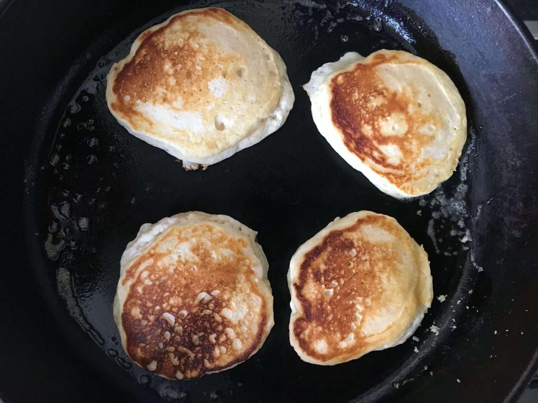 buttermilk pancakes cooking a cast iron pan