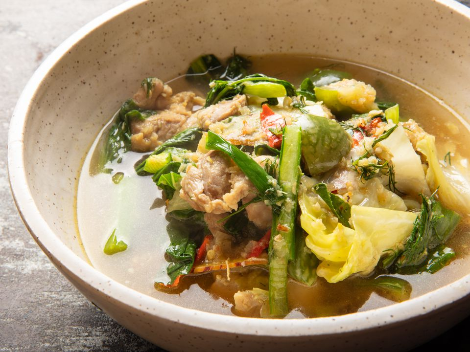 a close up of Gaeng Om Gai (Isan-Style Herbal Curry with Chicken and Dill) in a bowl