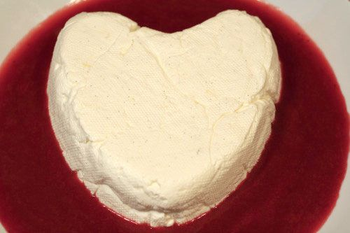 Coeur a la creme with strawberry sauce