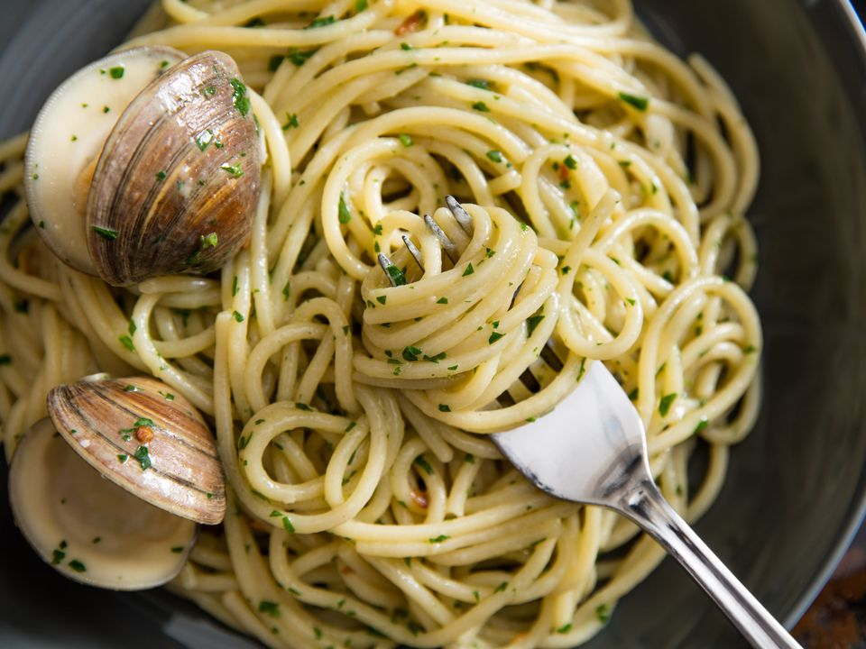 Spaghetti tossed in a sauce with clams, garlic, white wine and chile flakes.