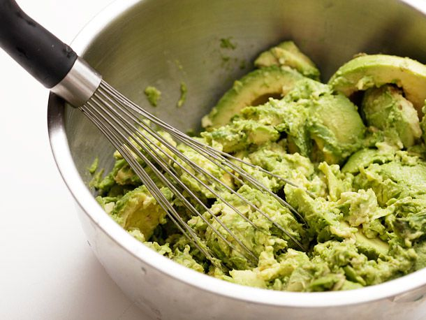 Mashing avocado with a whisk
