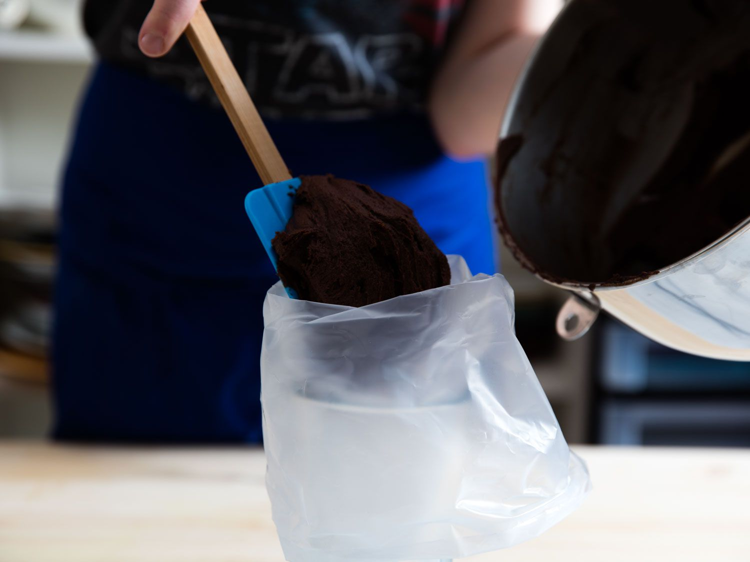 filling piping bag with chocolate