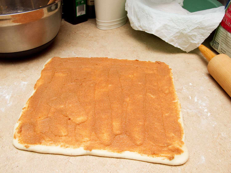 making homemade cinnamon bun
