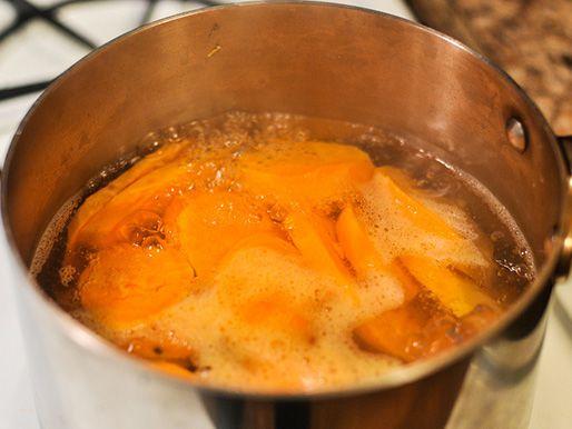 boiling sweet potatoes in saucepan