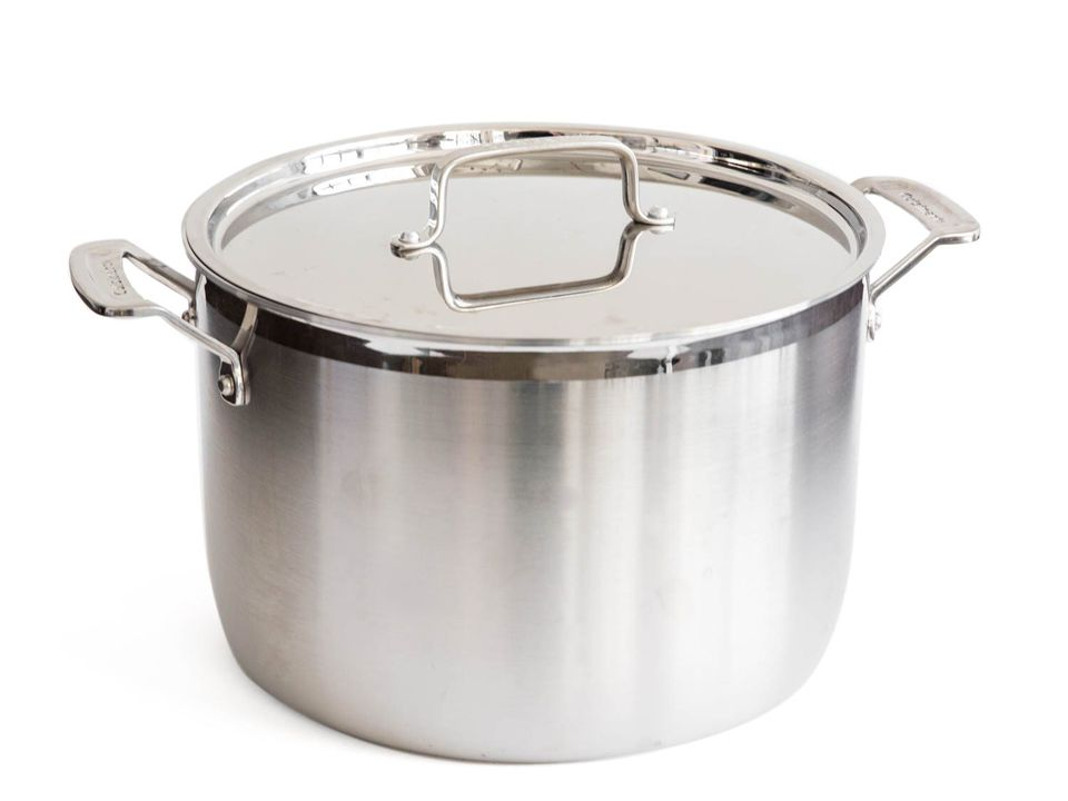 a stainless steel stockpot with a lid.