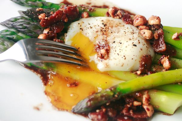 Asparagus and a poached egg with walnut vinaigrette.