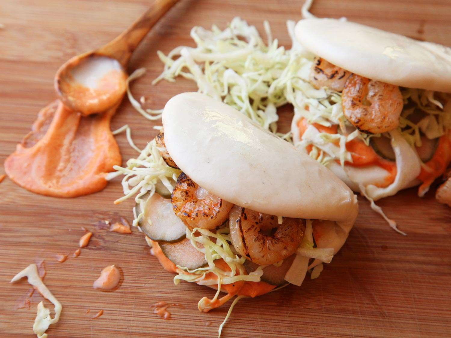 Steamed buns with grilled shrimp and sriracha mayo