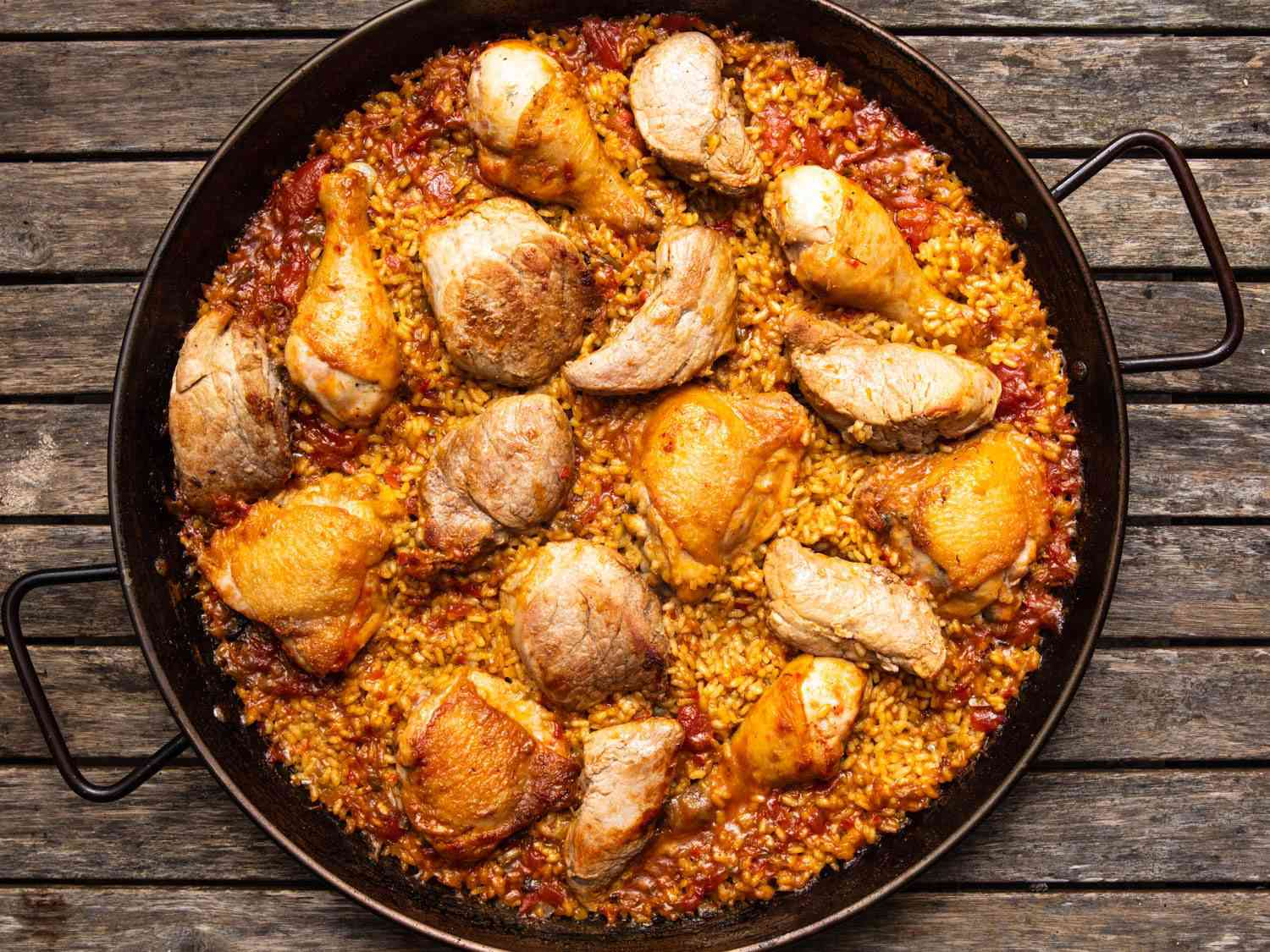 An all-meat (chicken and pork) paella shot from above.