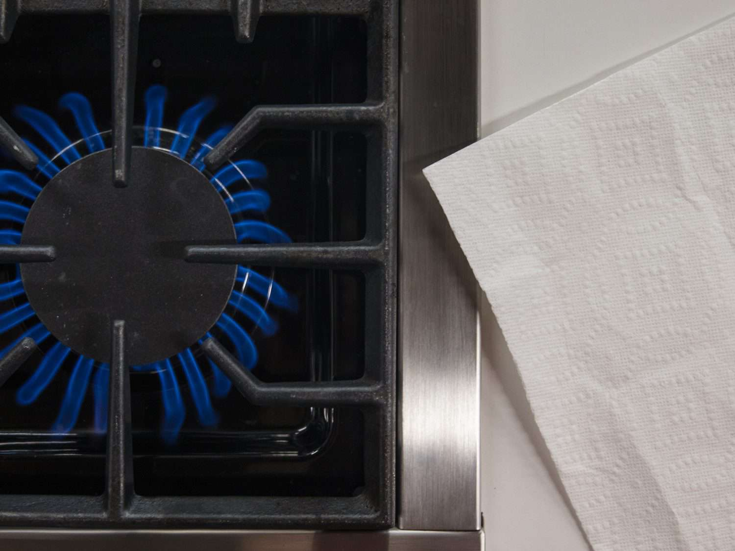 A paper towel that's too close to a kitchen burner flame: dangerous