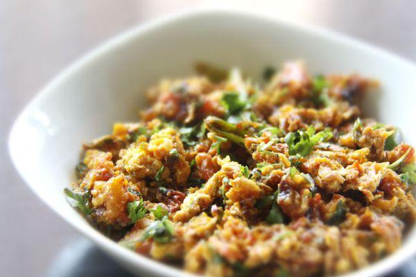 Anda Bhurji (Spicy Indian Scrambled Eggs) in a white bowl.