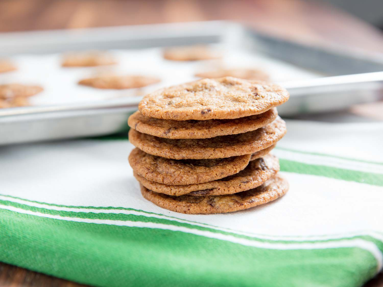 A stack of Tate's style thin chocolate chip cookies