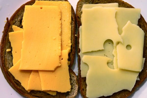 Adding cheese to a sandwich