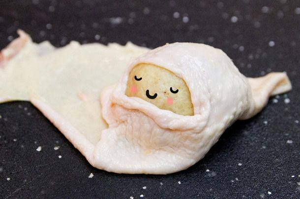 A matzo ball snugly cloaked in chicken skin, with a superimposed expression of contentment on its matzo
