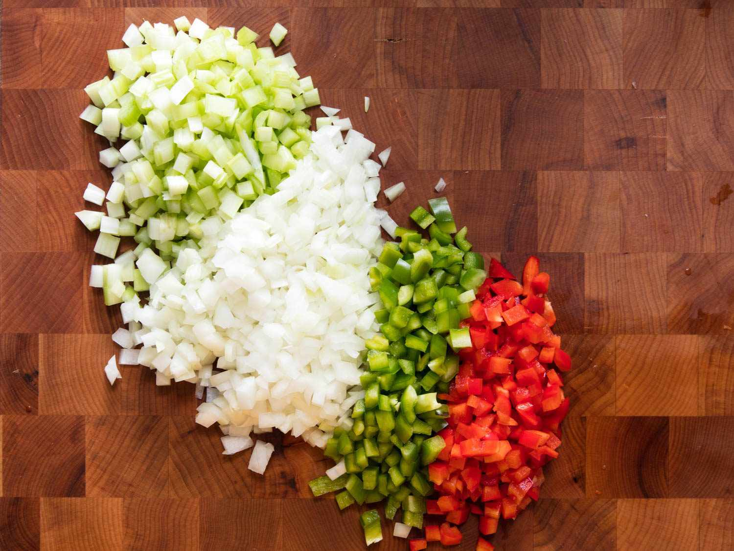 The holy trinity of creole and cajun cooking: diced onion, bell peppers, and celery