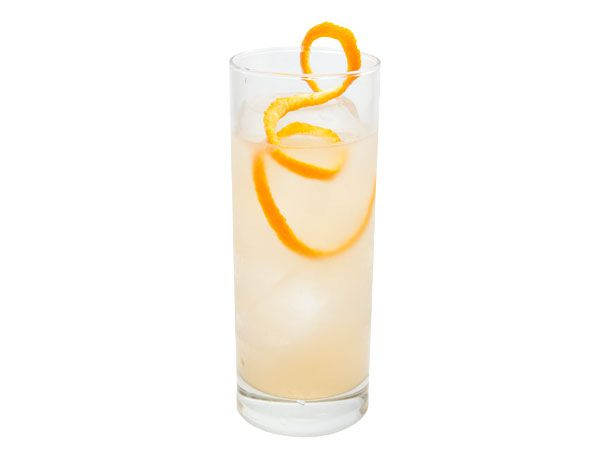 The Number 8, a ginger liqueur-based cocktail in a Collins glass with a long twist of grapefruit peel.