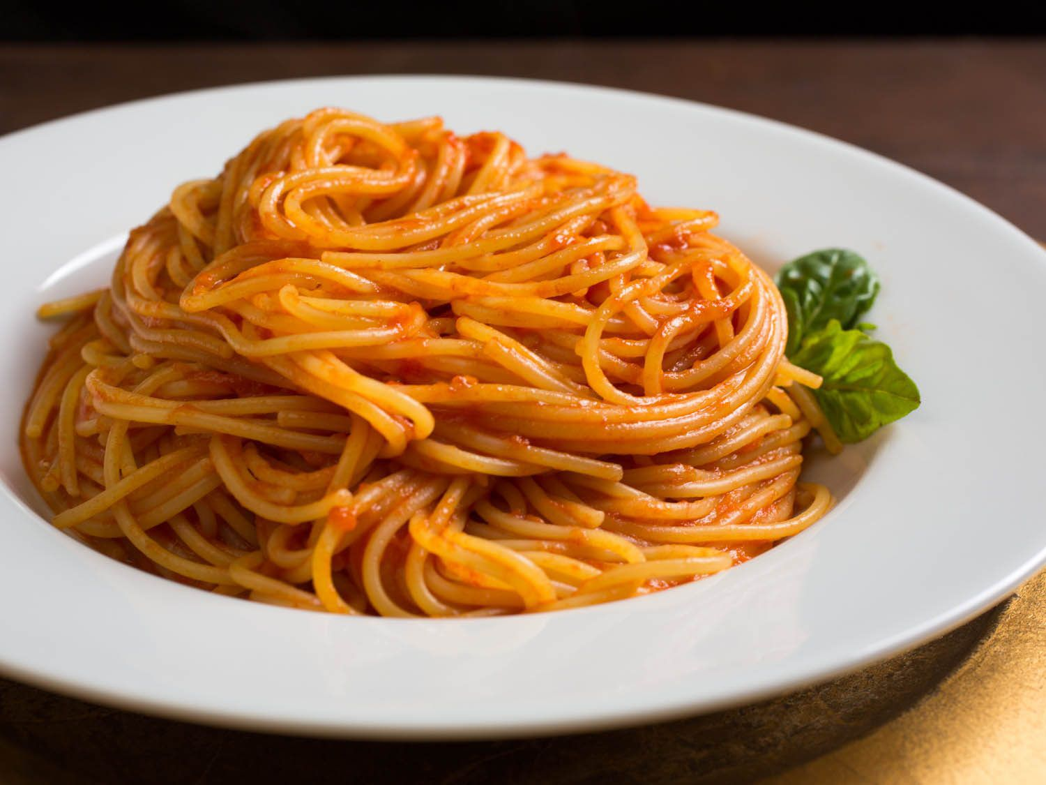 Plate of pasta with fresh tomato sauce.