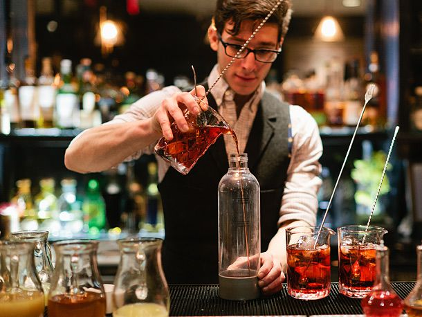 bartender pouring into Isi carbonating bottle