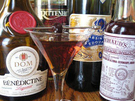 Several liquor bottles surrounding the La Louisiane cocktail.