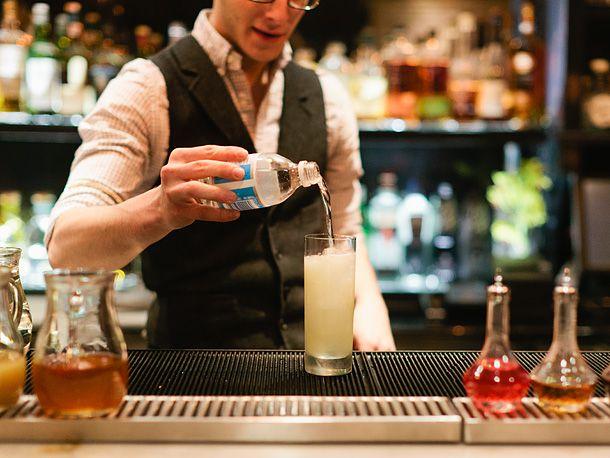 bartender pouring club soda