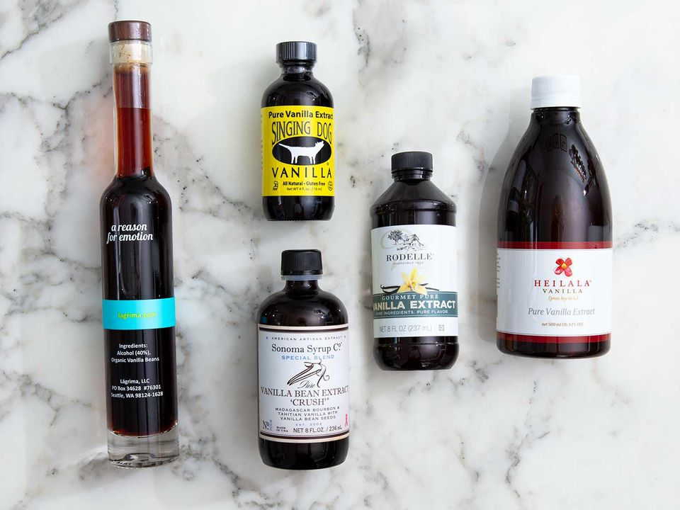 an assortment of vanilla extract bottles on a marble background
