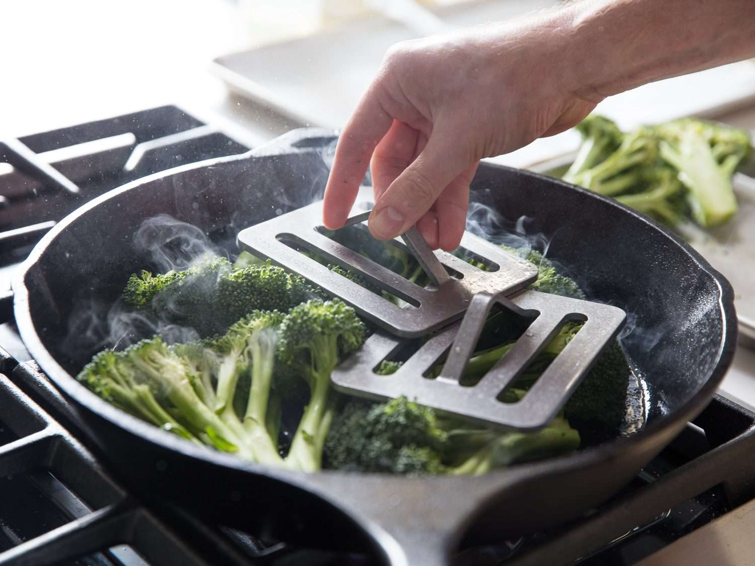 Using a Chef's Press for cooking broccoli.