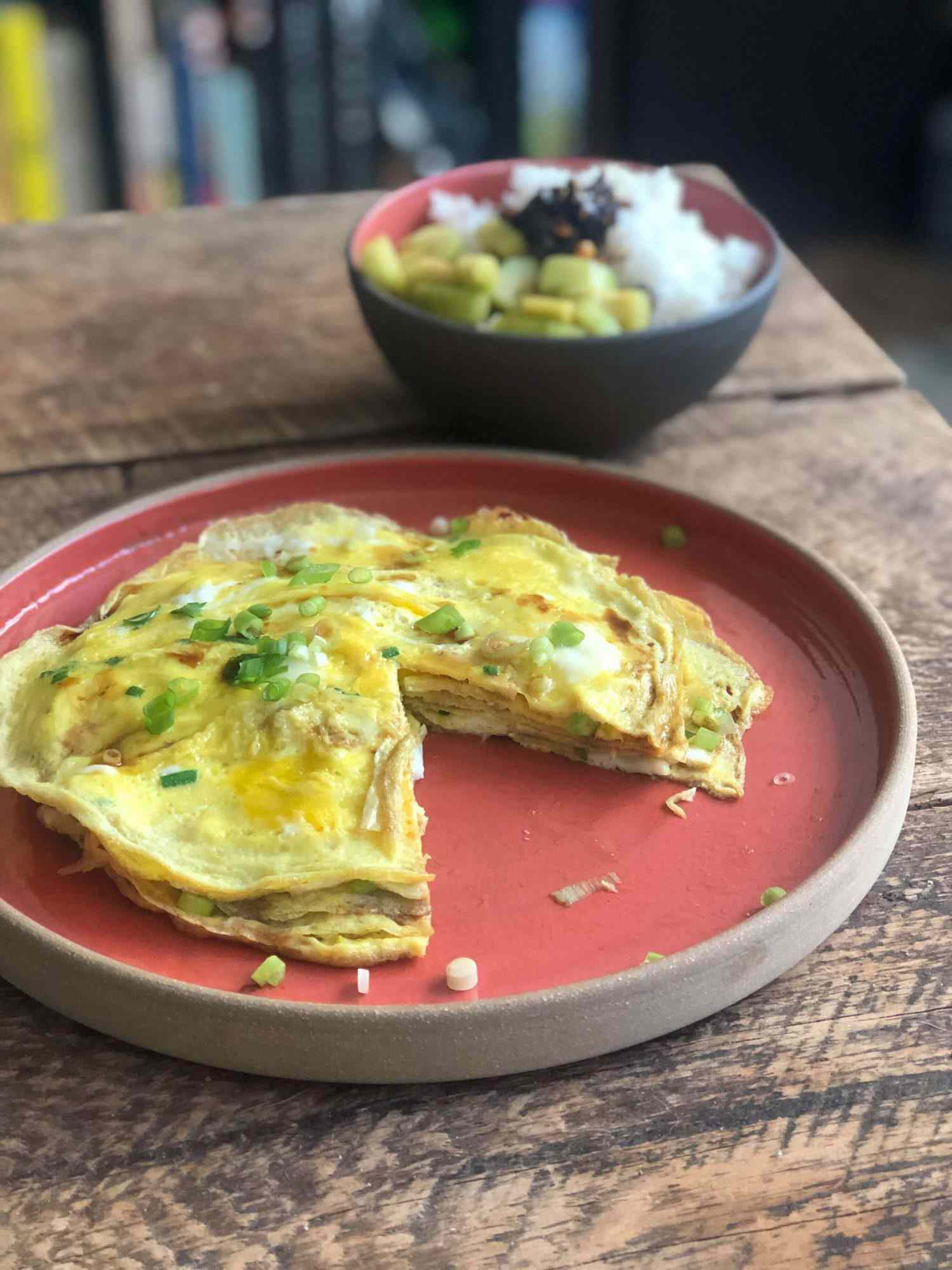 Layered scallion omelet on a plate