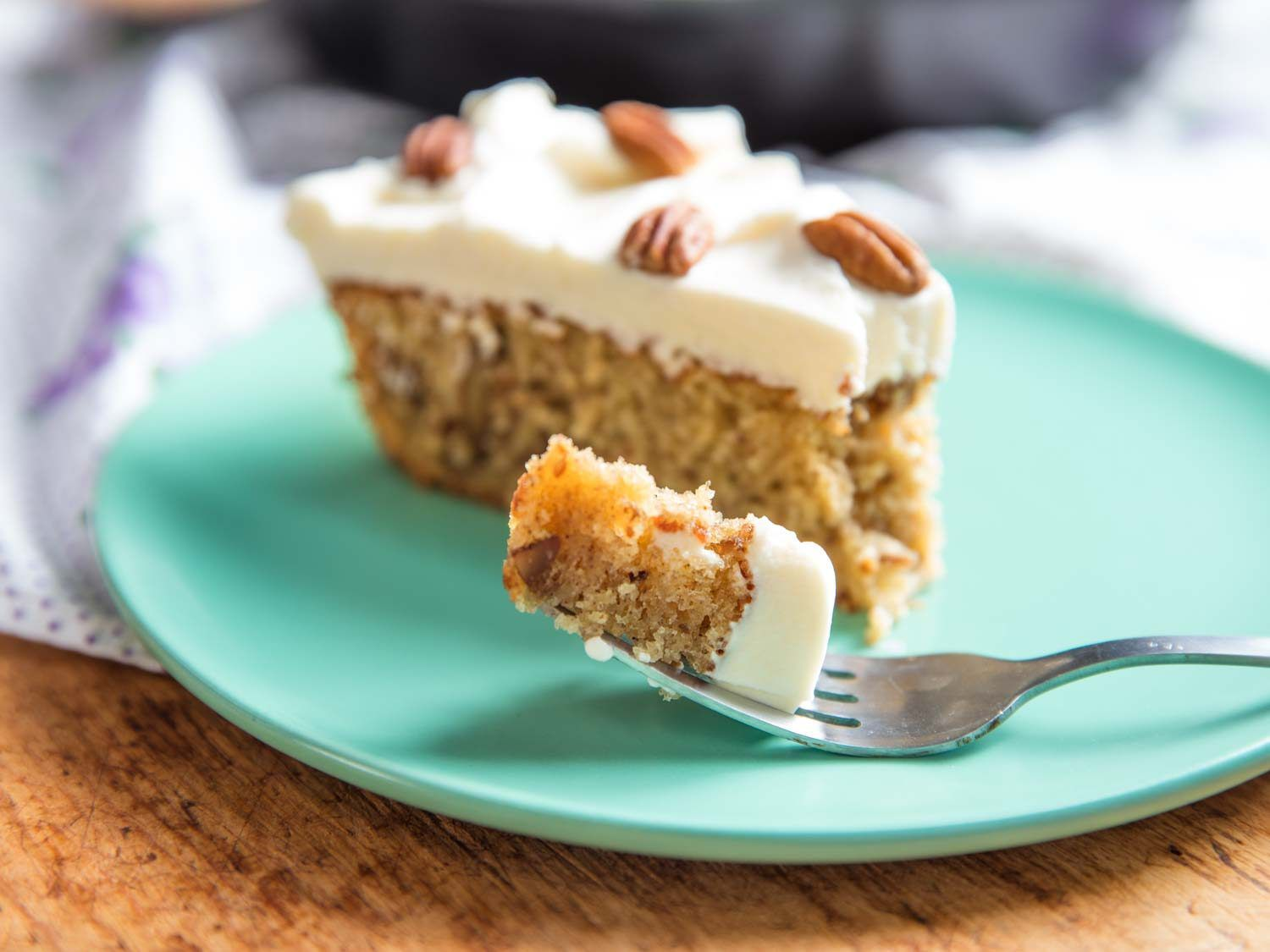 slice of hummingbird cake with forkful in focus