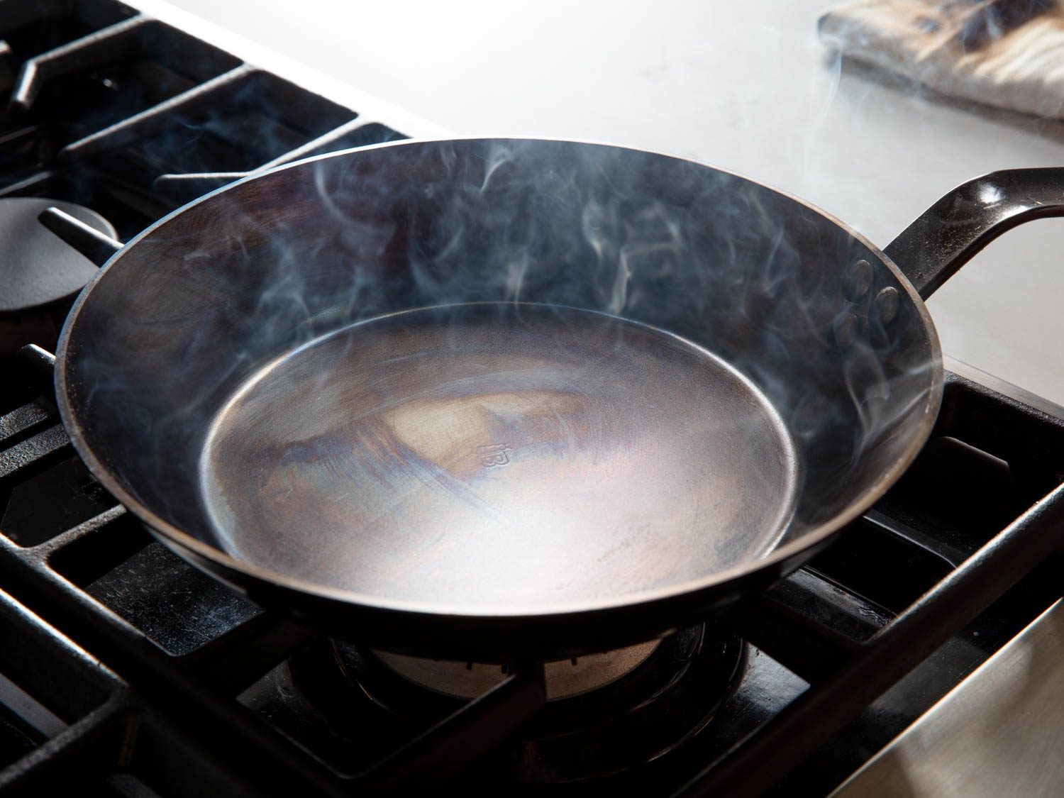 A carbon steel pan in the early stages of seasoning