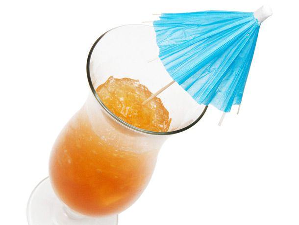 Hurricane cocktail with mini umbrella