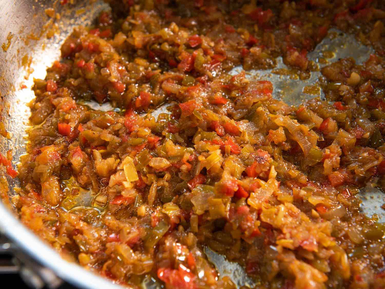 A sofrito made from aromatic vegetables, showing them nicely caramelized and ready to be used in a paella