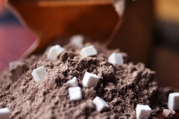 A pile of dry homemade cocoa mix with mini marshmallows