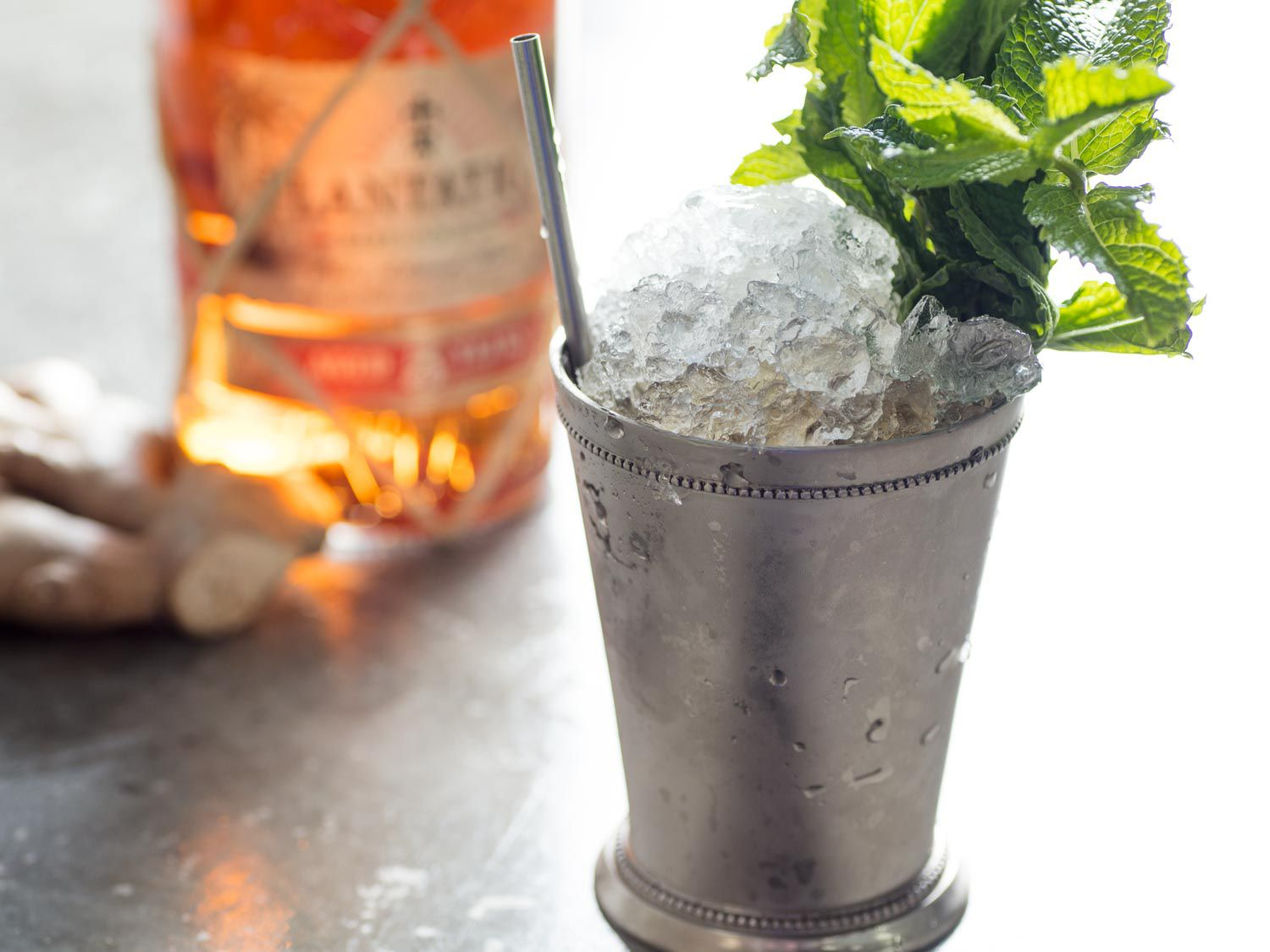 A Dark and Stormy mint julep (rum, ginger beer, mint, and maple syrup) in a frosted julep cup
