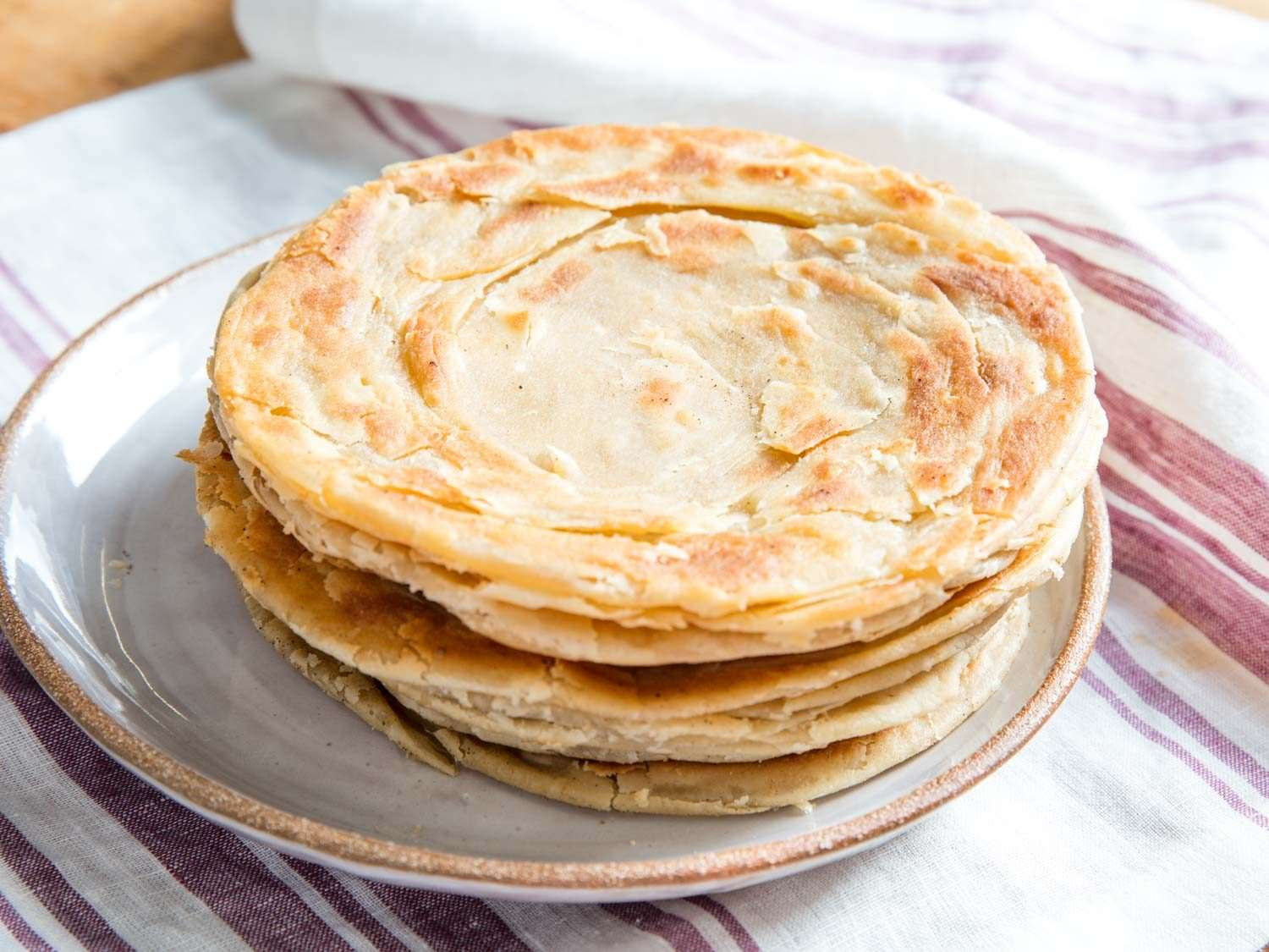 Stack of parathas: flaky, layered Indian flatbread.