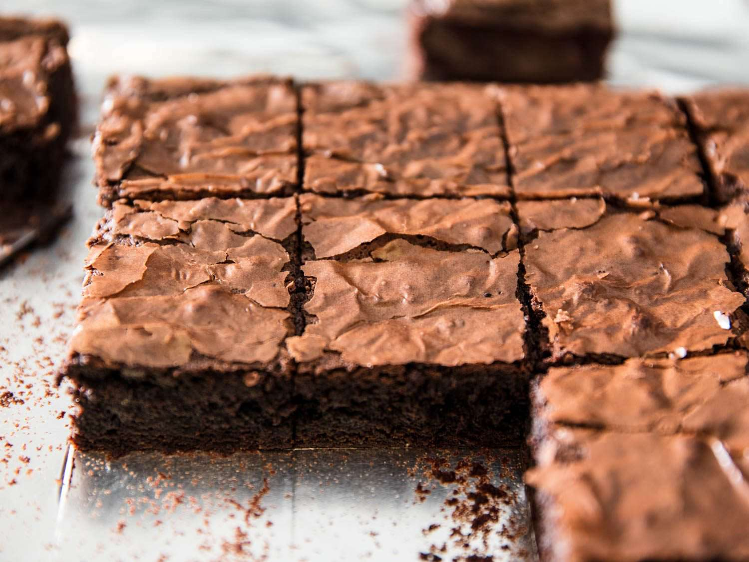 Baked glossy chocolate fudge brownies cut into squares