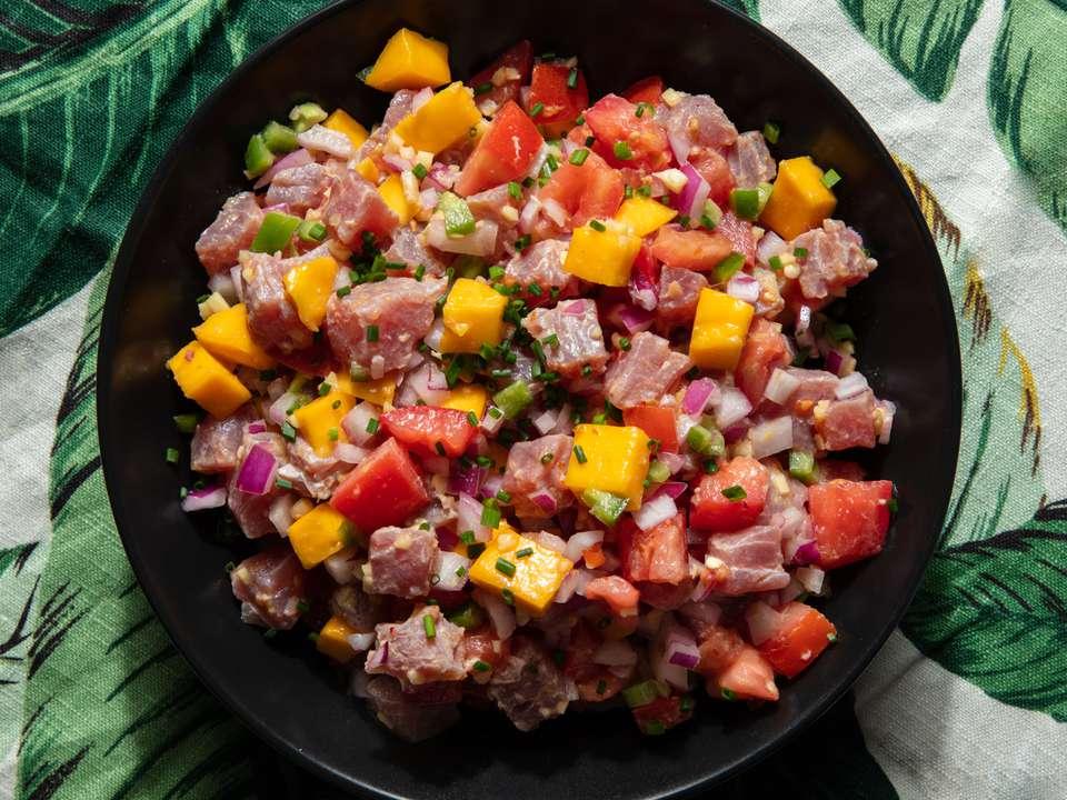 kinilaw (Filipino tuna ceviche) on a plate with a tropical print