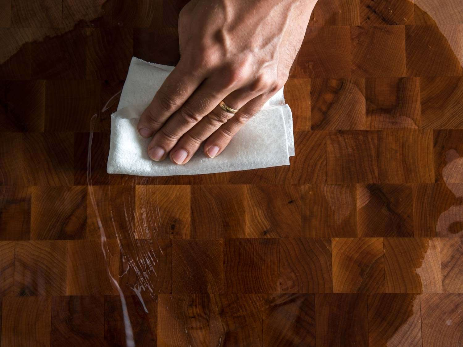 wiping mineral oil over a wood board