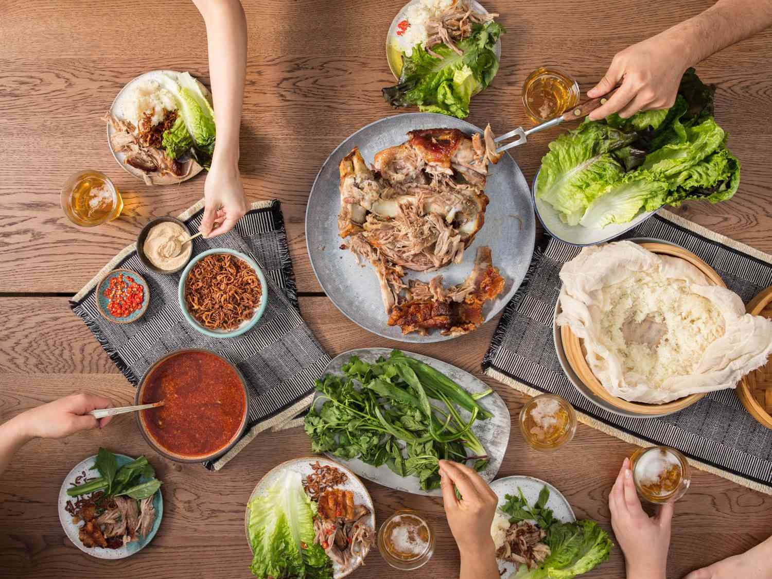 Sharing a Thai-inspired roast pork shoulder feast with a crowd.