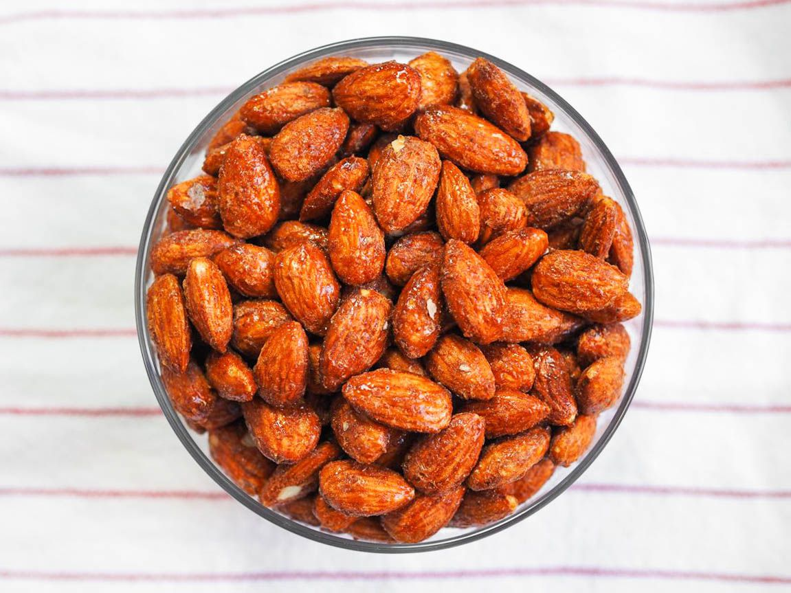 A glass bowl of homemade smoky candied almonds.
