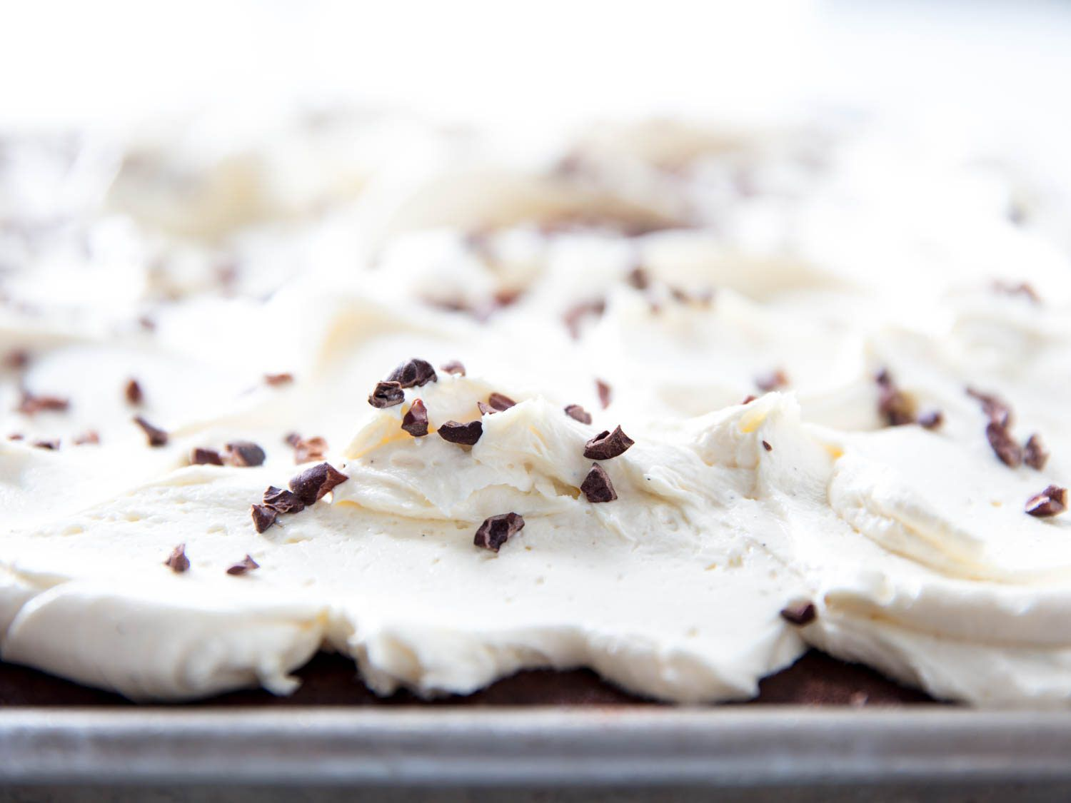 fluffy vanilla frosting with cocoa nibs