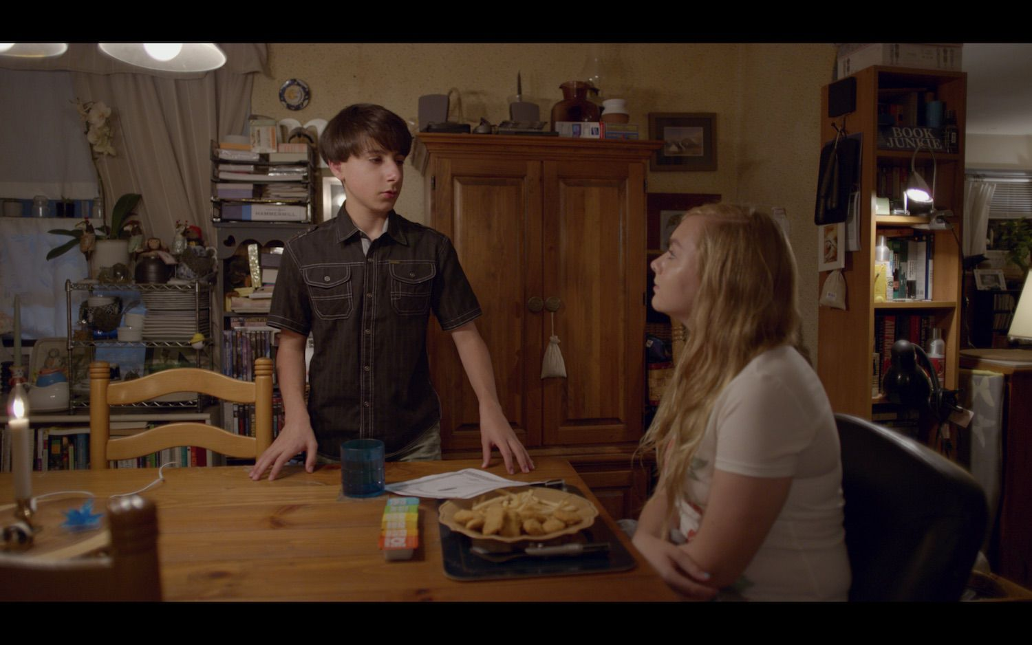 Eighth Grade film still at table with chicken nuggets.