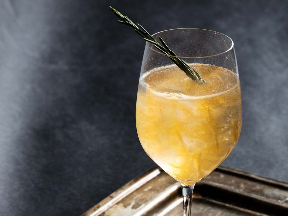 Two Turtledoves cocktail with rosemary sprig